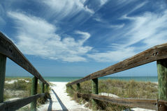 Serene beach boardwalk Royalty Free Stock Images