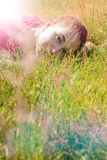 Serene beautiful young woman lying down, breathing nature, instagram effects Stock Photos