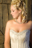 Serene beauty. Beautiful blond woman sitting lost in thought Royalty Free Stock Photography