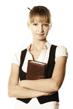 Serene blond businesswoman. With closed notepad hands folded Stock Photos