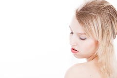 Serene blond teenager on white Royalty Free Stock Images