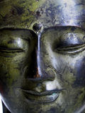 Serene buddha. A bronze buddha head with a very serene expression on its face royalty free stock image