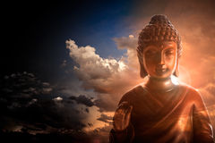 Buddha. Serene Buddha statue on stormy and cloudy background Royalty Free Stock Image