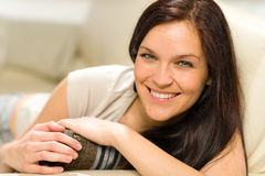 Serene cheerful woman lying on couch Royalty Free Stock Images
