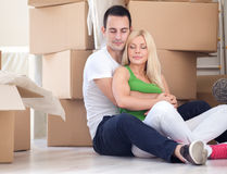 Serene couple enjoying in new home Stock Images
