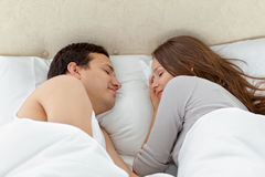 Serene couple sleeping together on their bed. At home Stock Images