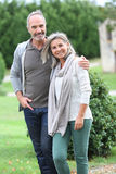 Serene couple standing in garden Stock Photos
