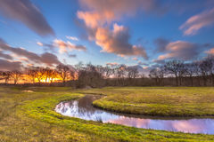 Serene Creek with Blurred Clouds Stock Image
