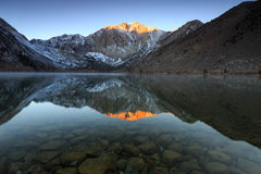 Serene dawn reflection at Convict Lake. Royalty Free Stock Images