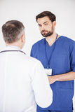 Serene doctors speaking in clinic Royalty Free Stock Image