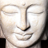 Serene face of a stone Buddha Royalty Free Stock Photo