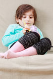 Serene girl with doll Royalty Free Stock Photo