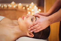 Serene girl getting facial massage at spa Royalty Free Stock Photography