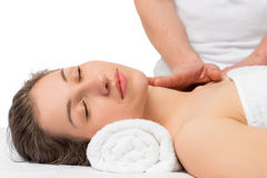 Serene girl on procedure of massage. Face and neck Stock Image