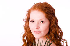 Serene girl with red hair. Closeup portrait. White balance corrected Royalty Free Stock Photography