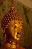 Serene golden Buddha statue Royalty Free Stock Images