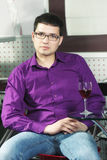 Serene guy in cafe with glass of wine Stock Photography