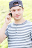Serene guy with phone Royalty Free Stock Photography