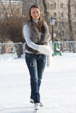 Serene ice-skating young woman Stock Photography