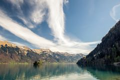 A serene lake brienz in switzerland. This image features a serene view of lake brienz in Switzerland royalty free stock photos