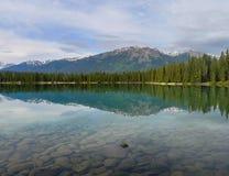 Serene lake in Jasper. Reflected serene view in Jasper Canada Royalty Free Stock Image