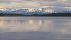 Serene lake by mountains. Video of serene lake by mountains stock video