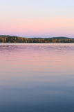 Serene lake scenery at dusk in Finland Stock Photos