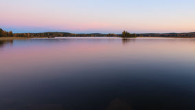 Serene lake scenery at dusk in Finland Royalty Free Stock Photo