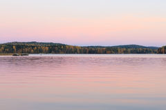 Serene lake scenery at dusk in Finland Royalty Free Stock Photos