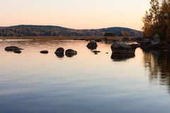 Serene lake scenery at dusk in Finland Royalty Free Stock Image