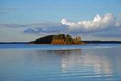 Serene lake in Sweden. Beautiful serene lake in Sweden with colorful autumn trees on shores Royalty Free Stock Photos