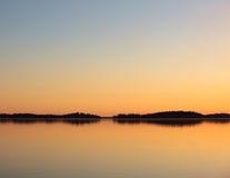 Serene lake view at dusk Stock Image