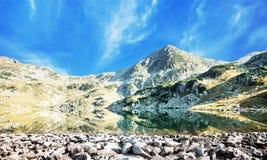 Serene Landscape of Mountain Peak and Lake in Carpathian Mountai Royalty Free Stock Images