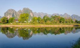 Serene landscape by the Nam Song River at Vang Vieng, Laos.  stock photography