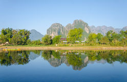 Serene landscape by the Nam Song River at Vang Vieng, Laos.  stock photo