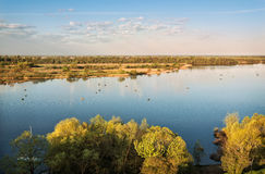 Serene landscape. Of a river in the morning and a lot of fishing boats Stock Photography