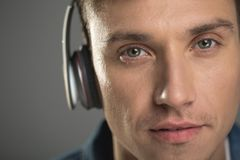 Serene male face with headphones stock photography