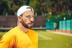 Serene male situating on green field royalty free stock photos