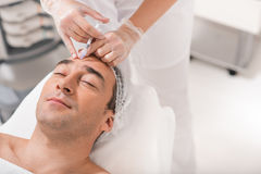 Serene man getting botox injection Stock Images