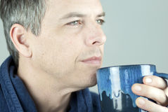 Serene Man Holding Mug Looking Off Camera stock photos