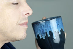 Serene Man Smelling Mug Royalty Free Stock Images