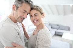 Serene mature couple at home embracing Stock Image