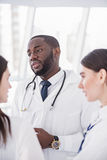 Serene medical advisers standing in clinic Stock Image