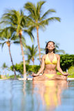 Serene meditating woman relaxing at luxury travel stock photo