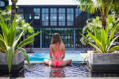 Serene meditating woman relaxing at luxury travel holiday vacation resort. Happy blissful young woman in bikini in Royalty Free Stock Photography
