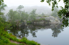 Serene misty morning on a lakeside Royalty Free Stock Images