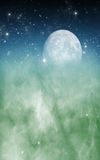 Serene Moon. A moon and stars background with clouds fading from blue to green Royalty Free Stock Photo