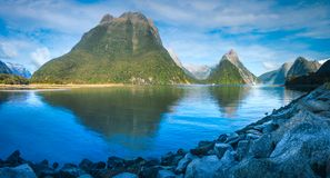 Serene Morning at Milford Sound. Morning at Freshwater Basin in Milford Sound with Mitre Peak and numerous other Mountain Cliffs in Fiordland National Park, New Royalty Free Stock Images