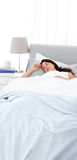Serene mother sleeping peacfully on the bed. In the morning Stock Photography