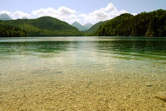 Serene mountain lake with transparent water Stock Images